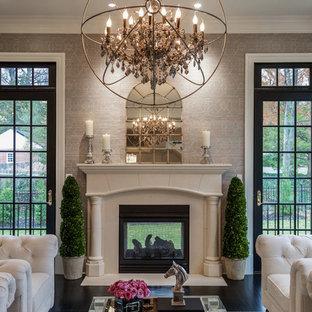 ワシントンD.C.のトランジショナルスタイルのおしゃれな独立型リビング (フォーマル、グレーの壁、両方向型暖炉、漆喰の暖炉まわり、黒い床) の写真