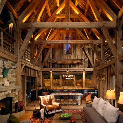 Example of a mountain style open concept living room design in Denver with a standard fireplace and a stone fireplace