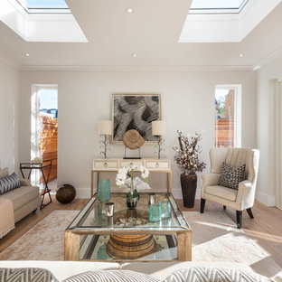 Photo of a medium sized classic enclosed living room in London with white walls and light hardwood flooring.
