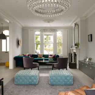Example Of An Ornate Living Room Design In London With Gray Walls