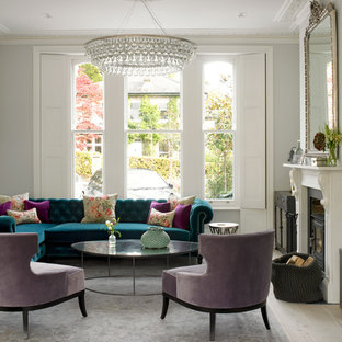 This is an example of a victorian living room in London with grey walls and a standard fireplace.