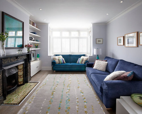 Mid Sized Trendy Enclosed Living Room Photo In London With A Standard Fireplace And Purple