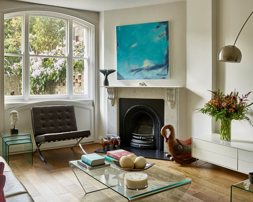 Photo Of A Bohemian Open Plan Living Room In London With White Walls,  Medium Hardwood