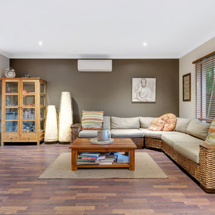 Eclectic formal open concept living room in Brisbane with beige walls, dark hardwood floors and brown floor.