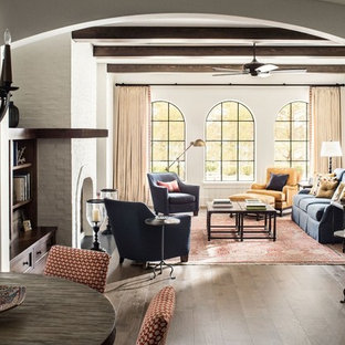 Mid-sized tuscan formal and enclosed dark wood floor and brown floor living room photo in Jacksonville with white walls, a standard fireplace, a brick fireplace and no tv