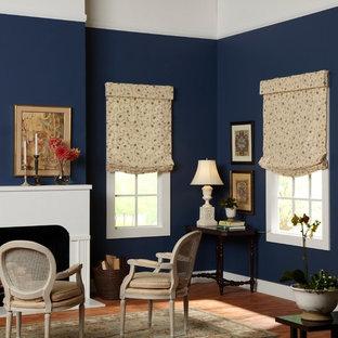 Immagine di un soggiorno chic di medie dimensioni e chiuso con sala formale, pareti blu, parquet scuro, camino classico, cornice del camino in intonaco, nessuna TV e pavimento marrone