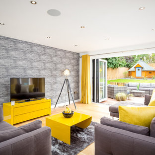Large contemporary enclosed living room in Gloucestershire with white walls, light hardwood flooring and a freestanding tv.
