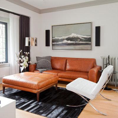 Living room - scandinavian open concept light wood floor living room idea in Vancouver with white walls