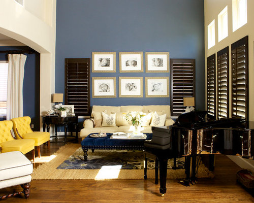 trendy brown floor living room photo in san diego with a music area and blue walls