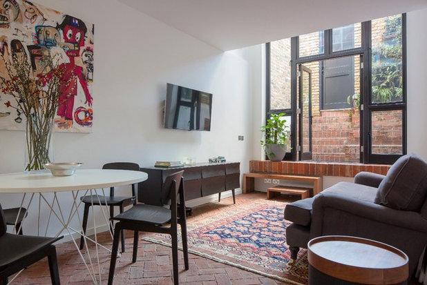 Industrial Living Room by Kirkwood McCarthy