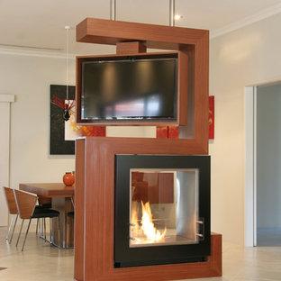 パースの大きいコンテンポラリースタイルのおしゃれなLDK (両方向型暖炉、白い壁、セラミックタイルの床、木材の暖炉まわり、白い床、テレビなし) の写真