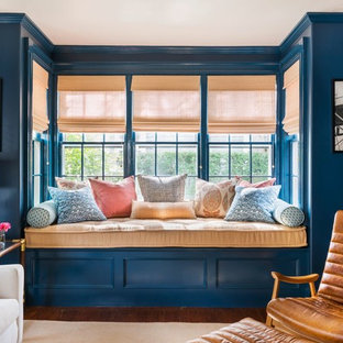 Inspiration for a mid-sized timeless medium tone wood floor living room remodel in Orange County with blue walls