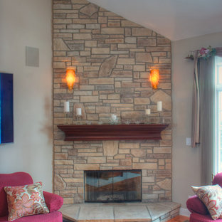 Inspiration for a mid-sized midcentury modern open concept light wood floor and brown floor living room remodel in Chicago with beige walls, a corner fireplace, a stone fireplace and no tv