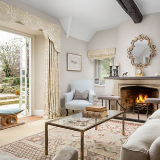 Photo of a medium sized country formal living room in Gloucestershire with grey walls and a standard fireplace.