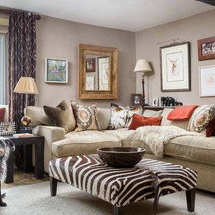 This is an example of a medium sized country enclosed living room in Gloucestershire with beige walls.