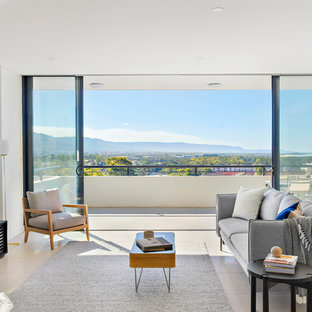Contemporary formal open concept living room in Wollongong with beige walls and beige floor.