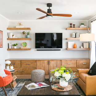 Living room - contemporary medium tone wood floor and brown floor living room idea in Dallas with white walls and a wall-mounted tv