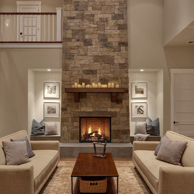 Example of a transitional living room design in Seattle with beige walls, a standard fireplace and a stone fireplace
