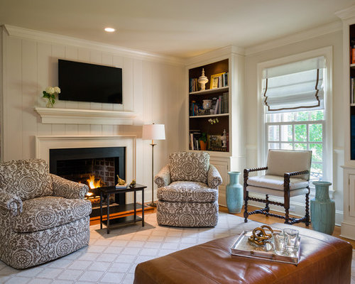 Example of a classic formal medium tone wood floor living room design in  New York with - Painted Bookcases Houzz