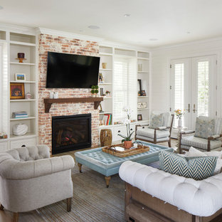 Large country open plan living room in Austin with white walls, a standard fireplace, a brick fireplace surround, a wall mounted tv, medium hardwood flooring and brown floors.