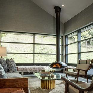 Inspiration för ett mellanstort funkis separat vardagsrum, med ett finrum, grå väggar, betonggolv och en hängande öppen spis