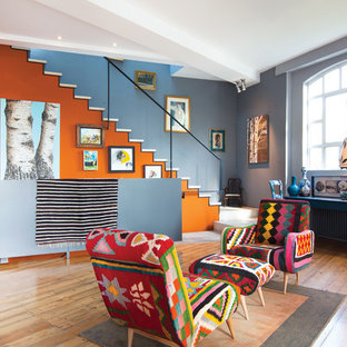 Photo of an eclectic formal open plan living room in London with multi-coloured walls and medium hardwood flooring.