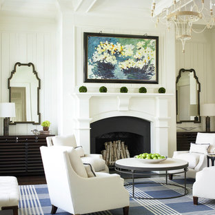 Elegant living room photo in Atlanta with white walls, a standard fireplace and no tv