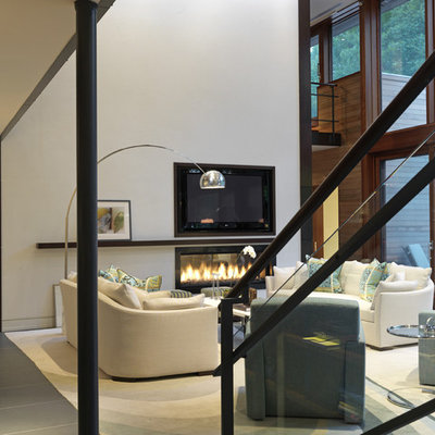 Example of a trendy living room design in Baltimore with white walls, a ribbon fireplace and a wall-mounted tv