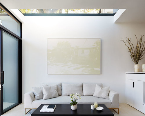 This Is An Example Of A Modern Open Concept Living Room In Sydney With  White Walls
