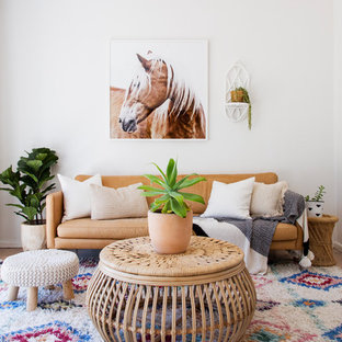 Design ideas for a beach style living room in Wollongong with white walls, medium hardwood floors and brown floor.