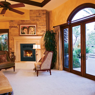 Elegant living room photo in Orange County with a standard fireplace