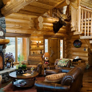 Living Room   Rustic Living Room Idea In Boise With A Standard Fireplace  And A Stone