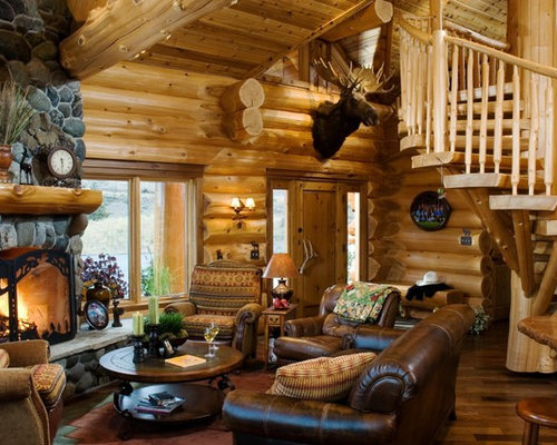 Rustic living room idea in Boise with a standard fireplace and stone  Small Log Cabin Living Room Ideas Photos Houzz