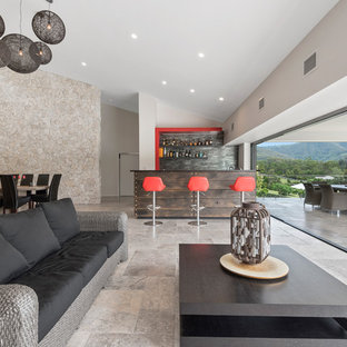 Contemporary living room in Brisbane with beige walls, no fireplace, no tv and grey floor.