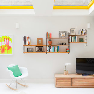 Contemporary Living Room In London With White Walls, Painted Wood Flooring  And A Freestanding Tv