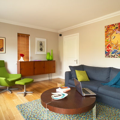 Example of an eclectic living room design in Dublin with beige walls