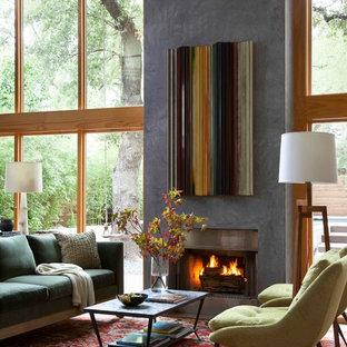 Esempio di un soggiorno contemporaneo aperto con sala formale, camino classico, nessuna TV e cornice del camino in cemento
