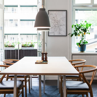 Medium sized scandi open plan dining room in Stockholm with white walls, painted wood flooring and no fireplace.