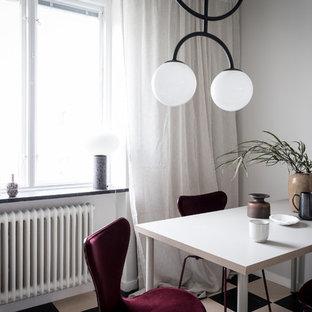 Idéer för att renovera en skandinavisk matplats, med vita väggar och flerfärgat golv