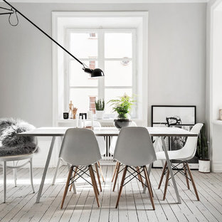 Enclosed dining room - mid-sized scandinavian painted wood floor enclosed dining room idea in Stockholm with white walls and no fireplace