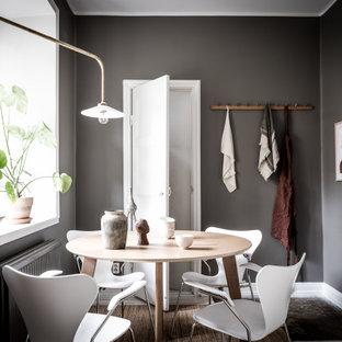 Inredning av en nordisk matplats, med grå väggar och grått golv