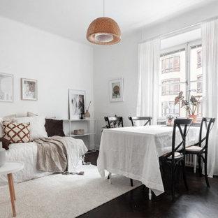 Idéer för att renovera en liten minimalistisk matplats, med vita väggar och svart golv