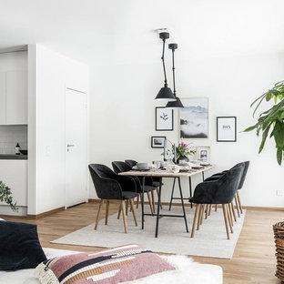 Idéer för att renovera en mellanstor nordisk matplats med öppen planlösning, med vita väggar, mellanmörkt trägolv och brunt golv