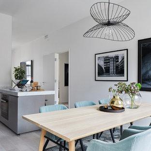 Inspiration för nordiska matplatser, med vita väggar och grått golv