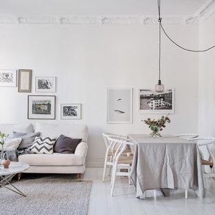 Idéer för att renovera en skandinavisk matplats med öppen planlösning, med vita väggar, målat trägolv och vitt golv