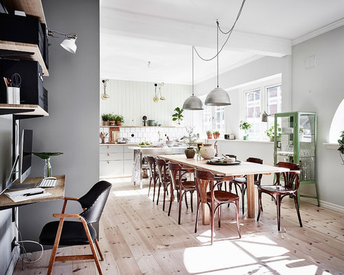 Example Of A Large Country Great Room Design In Gothenburg With Green Walls And Light Hardwood