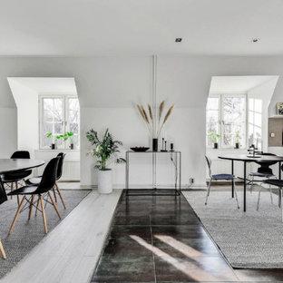 Idéer för en skandinavisk matplats, med vita väggar och grått golv