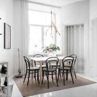 Bild på ett mellanstort nordiskt kök med matplats, med vita väggar, målat trägolv och vitt golv