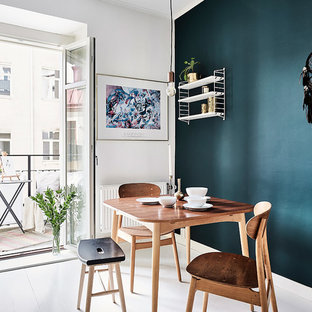 Dining room - mid-sized scandinavian painted wood floor dining room idea in Gothenburg with blue walls and no fireplace