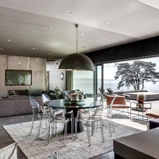 Idéer för att renovera en stor funkis matplats med öppen planlösning, med grå väggar, betonggolv och grått golv